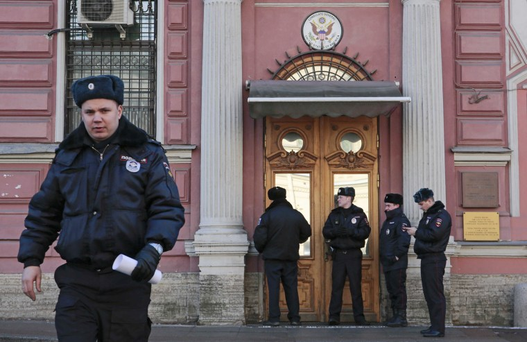 Image: Policemen stand guard outside the building of the consulate-general of the U.S. in St. Petersburg