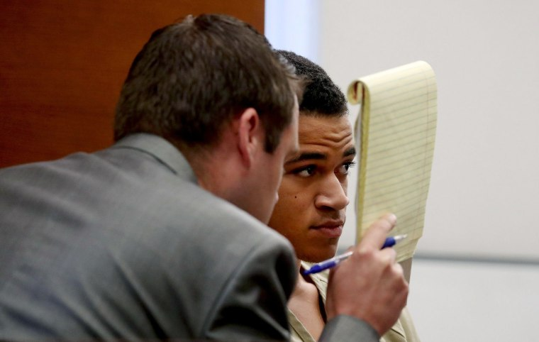 Image: Zachary Cruz, 18, brother of Nikolas Cruz, who killed 17 people at Marjory Stoneman Douglas High School last month, speaks with his attorney Joseph Kimok as he waits for his bond hearing to begin in Broward court in Fort Lauderdale