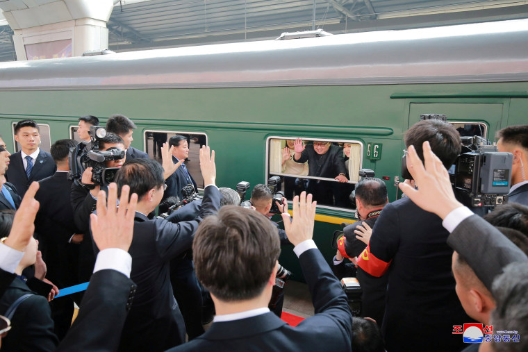 Image: North Korean leader Kim Jong Un waves from a train as he paid an unofficial visit to China