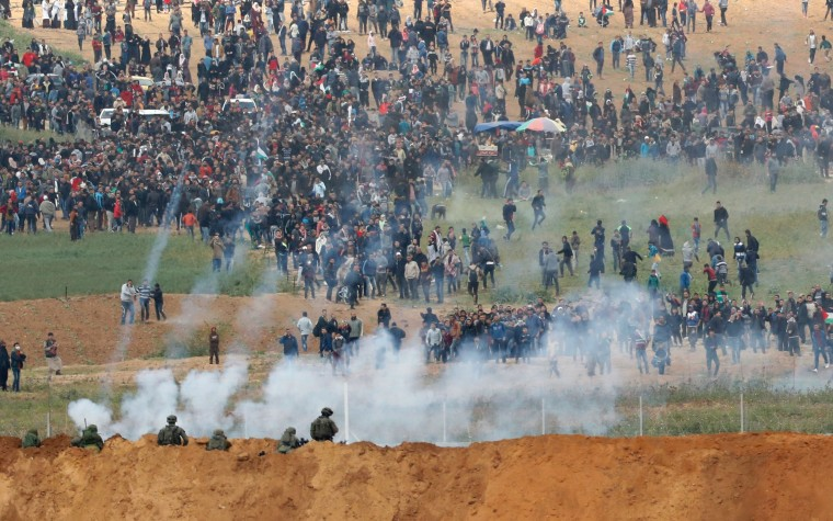 Image: Israeli forces shoot tear gas at Palestinian protesters along the Gaza - Israeli border fence