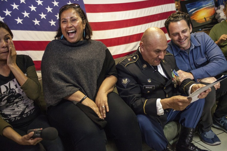 Image: Deported U.S. Army veteran Hector Barajas-Varela celebrates after immigration officials announced he received American citizenship