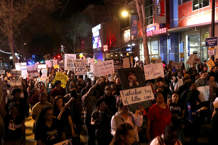 Image: Black Lives Matter protesters march through the streets of Sacramento during a demonstration on March 30, 2018 in Sacramento, California.