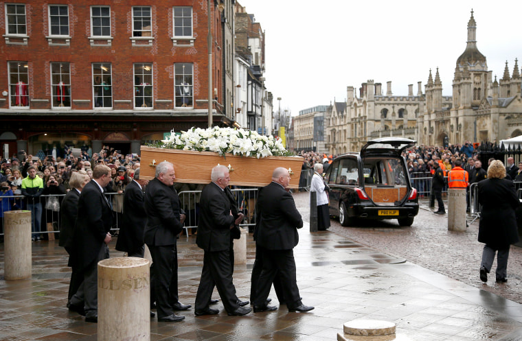 Image: Pallbearers carry the coffin out of Great St Marys Church at the end of the funeral of theoretical physicist Prof Stephen Hawking, in Cambridge