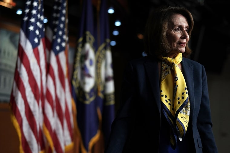 Image: House Minority Leader Rep. Nancy Pelosi leaves after a weekly news conference