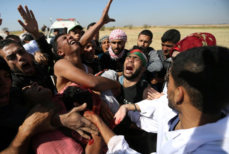 People react as they evacuate deaf Palestinian Tahreer Abu Sabala, 17, who was shot and wounded in the head during at the border, in the southern Gaza Strip on April 1.