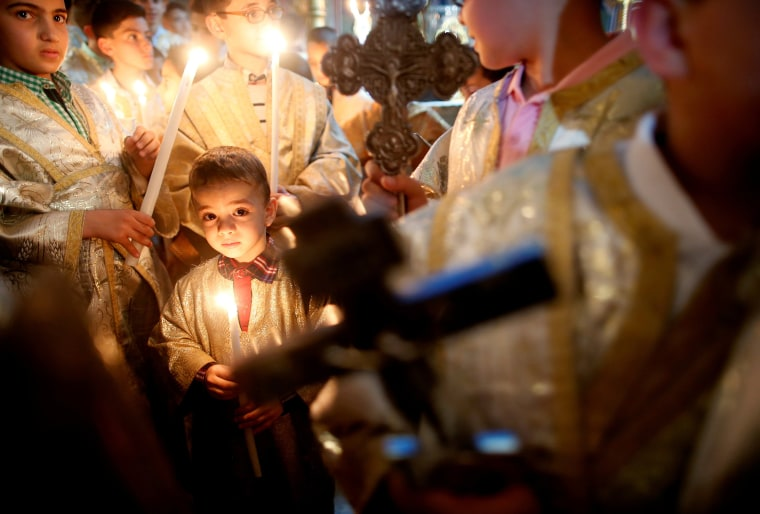 Image: Palestinian Christians attend a service on Easter Sunday at the Saint Porfirios church in Gaza City