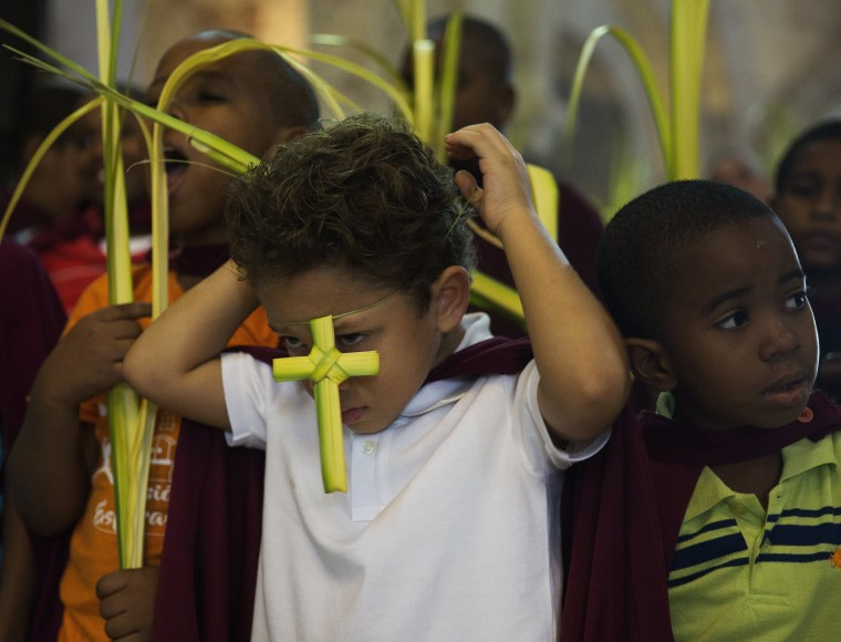 Image: Catholic devotees participate in the Palm Sunday mass