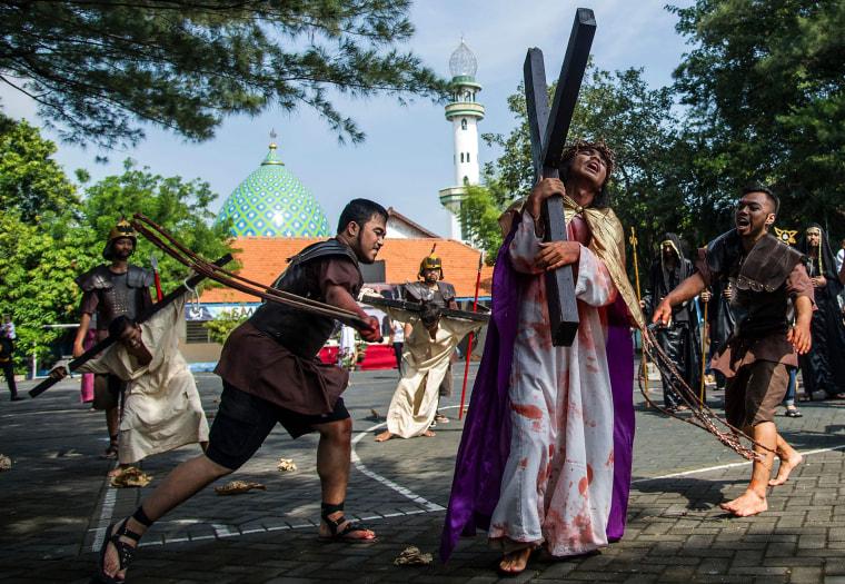 Image:  Catholics reenact the crucifixion of Jesus Christ