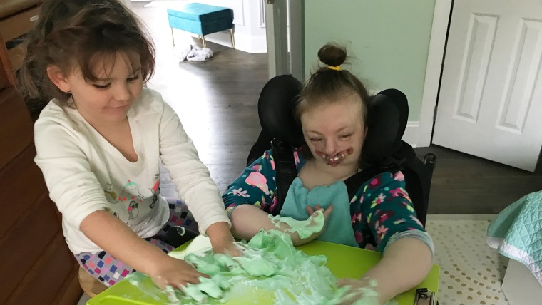 Despite having numerous health conditions and physical deformities, Sophia remains happy and sweet. She loves playing with her sister Lyla.