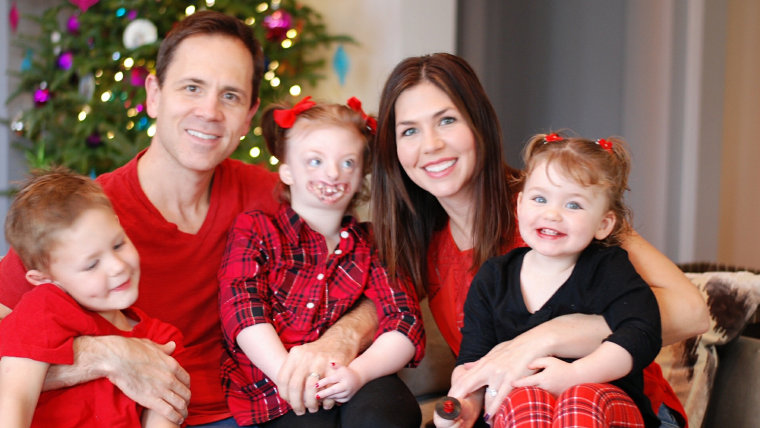 Natalie Weaver, here with kids Sophia, Lyla, 4, Alex, 7, and husband, Mark, has increased her activism.