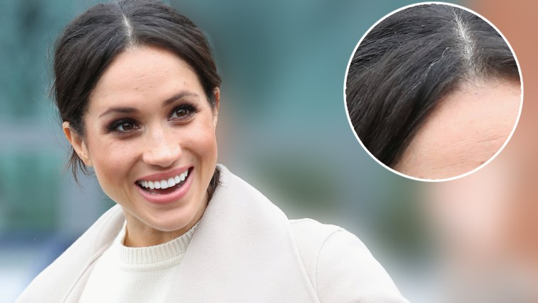 Image: The fiancee of Britain's Prince Harry, Meghan Markle, reacts after a visit to a science park called Catalyst Inc., in Belfast