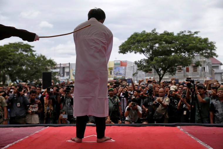 Image: An Indonesian man is publicly caned for having gay sex, in Banda Aceh