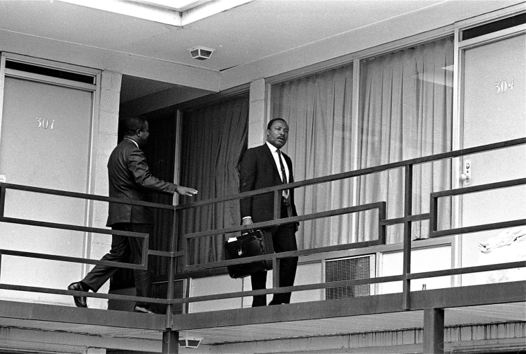 Image: Martin Luther King Jr. walking across the balcony of the Lorraine Motel in Memphis