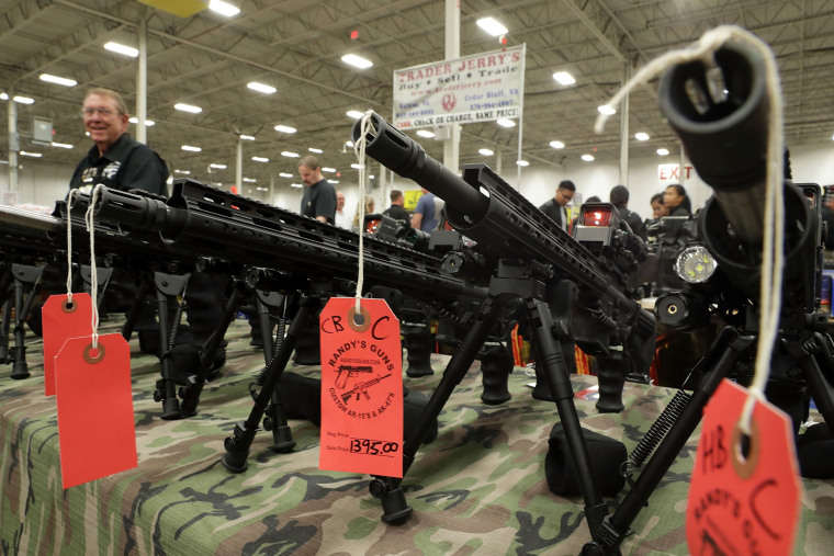 Image: AR-15 rifles are on display