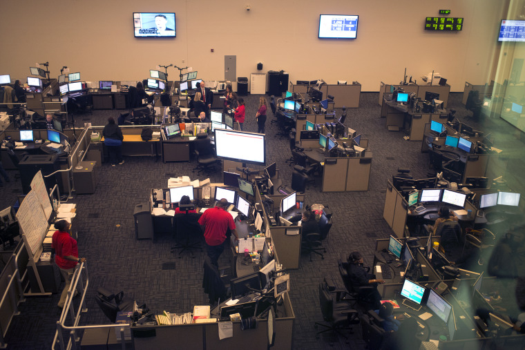 Image: The call center where dispatchers are working 12-hour overtime shifts to keep up with a record number of calls in Washington