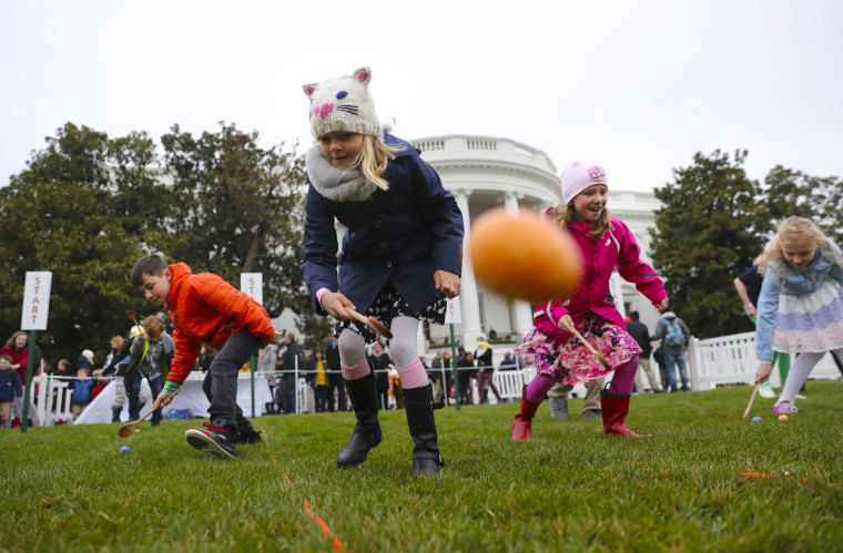 Image: Children participate in the annual White House Easter Egg Roll on the South Lawn of the White House