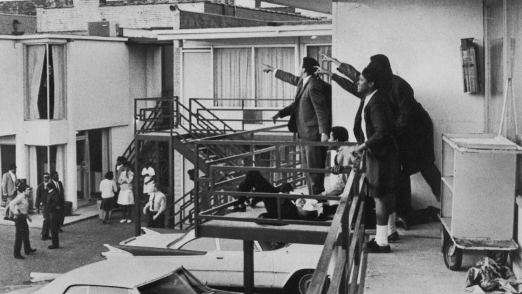 Associates of Martin Luther King Jr. point toward the sound where the gunfire originated just moments after his assassination at the Lorraine Motel on April 4, 1968, in Memphis, Tenn.