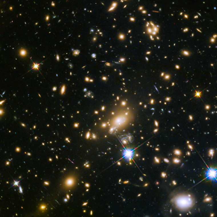 This image shows the huge galaxy cluster MACS J1149.5+223, whose light took over 5 billion years to reach us.