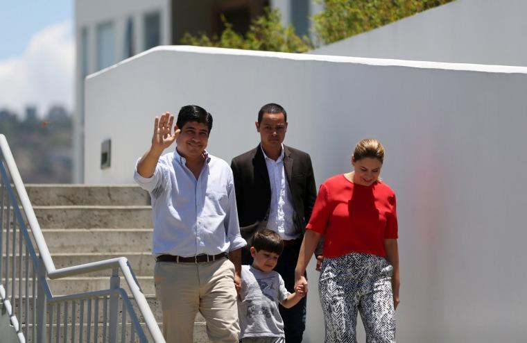Image: Costa Rica's president-elect Alvarado greets media outside his house in San Jose