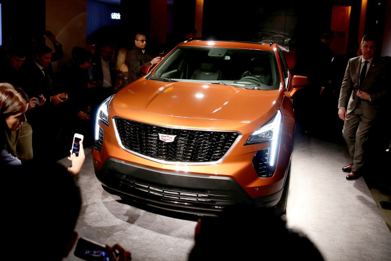 Image: Visitors take photos after Cadillac unveils the new XT4 SUV in advance of the New York Auto Show in the Manhattan borough of New York City