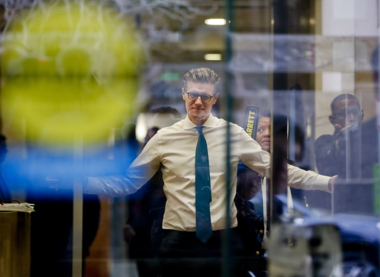 Image: Alex van der Zwaan raises his arms as he goes through security check point
