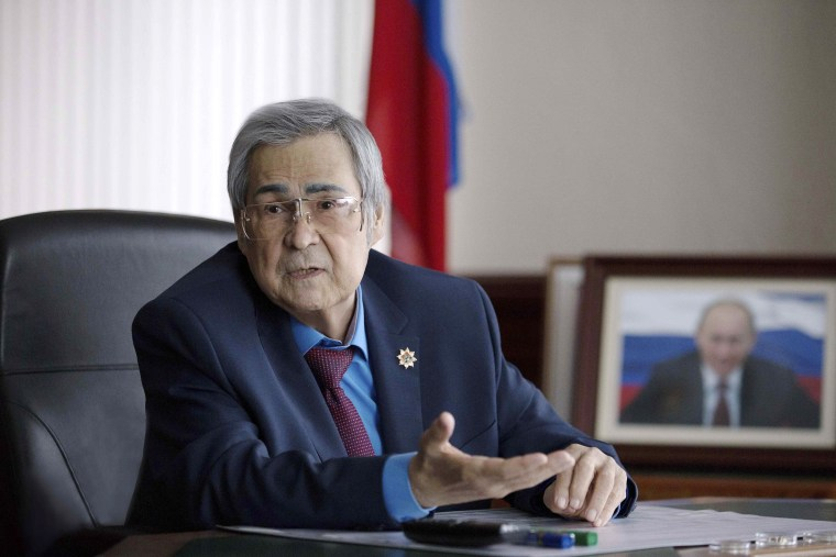 Image: Governor of the Kemerovo Region Aman Tuleyev speaks during a meeting in Kemerovo