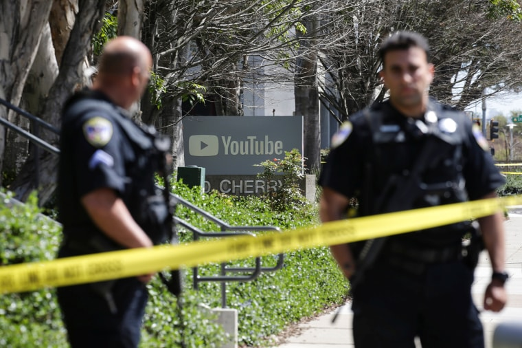 Image: Police officers and crime scene tape are seen at Youtube headquarters following an active shooter situation in San Bruno, California
