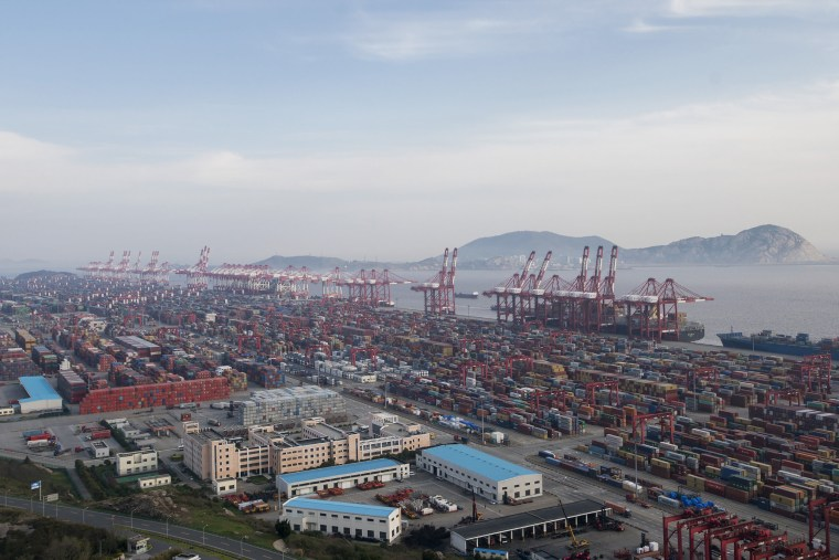 Image: A container ship is docked at the Yangshan port in Shanghai