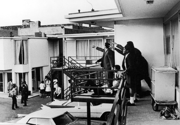 Image: Associates of Martin Luther King Jr. stand on the balcony of the Lorraine Motel moments after his assassination