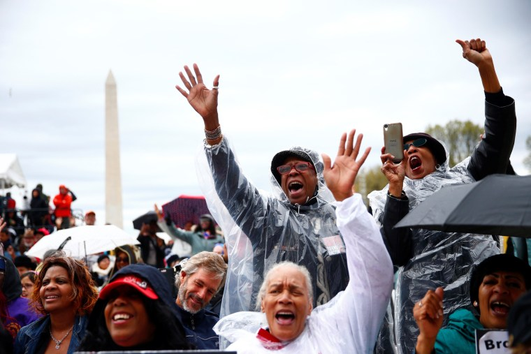 Image: Attendees are seen during a march and rally on the National Mall to mark the 50th anniversary of the assassination of civil rights leader Martin Luther King Jr. in Washington