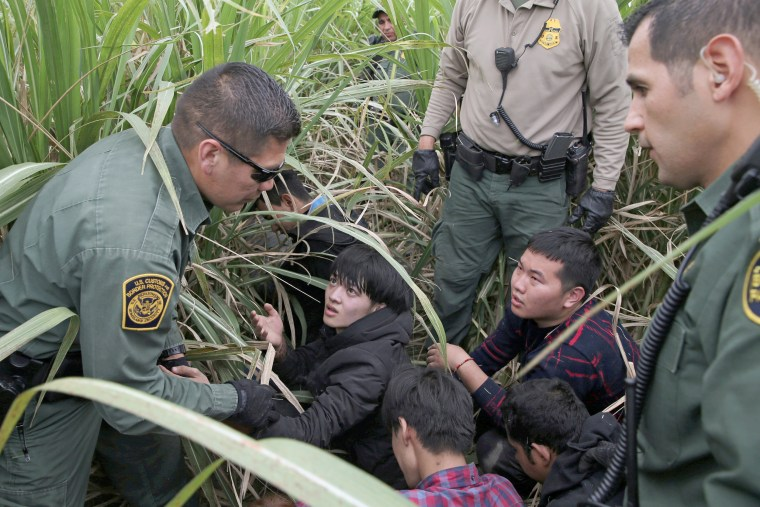 Border patrol agents apprehend immigrants who illegally crossed the border from Mexico into the U.S. in the Rio Grande Valley sector, near McAllen, Texas on April 3.