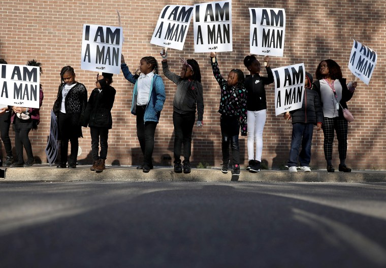 Children from Promise Academy Spring Hill hold 'I Am A Man' signs, in reference to the sanitation workers strike in 1968, as they participate in an event to mark the 50th anniversary of Dr. Martin Luther King Jr.'s assassination on April 4, in Memphis, Tennessee. American civil rights leader King was killed on April 4, 1968 while supporting a sanitation workers strike in Memphis.   In Washington, a wreath was laid at the MLK memorial, and his son Martin Luther King III accompanied by wife Arndrea Waters King attended a ceremony at Memphis' Mason Temple Church of God in Christ.