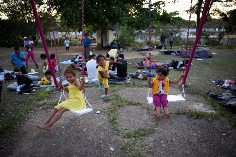 "Central American children taking part in a caravan called ""Migrant Viacrucis"" play at a sports center field in Matias Romero, Oaxaca state, Mexico on April 2. 