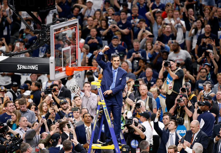 Villanova head coach Jay Wright cheers as he cut down the net after beating Michigan 79-62 in the championship game of the Final Four NCAA college basketball tournament in San Antonio on April 2. This is the second NCAA national championship in three years for Villanova, making the team the only fourth program since UCLA to win two titles in the span of three years -- joining Duke, Kentucky and Florida.