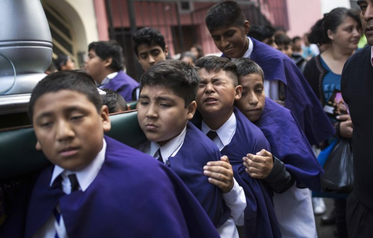 Children carry the image of Jesus Christ while taking part in a Holy Week procession in Lima, Peru, on April 1. Traditionally, processions take place throughout Peru during the Easter Holy Week.