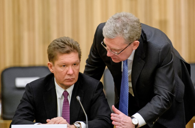Alexei Miller, left, chairman of the management board of Gazprom, talks with Alexei Kudrin, chairman of the board for the Center for Strategic Research, in 2017. Miller is one of those targeted in the Trump administration's sanctions announced Friday.