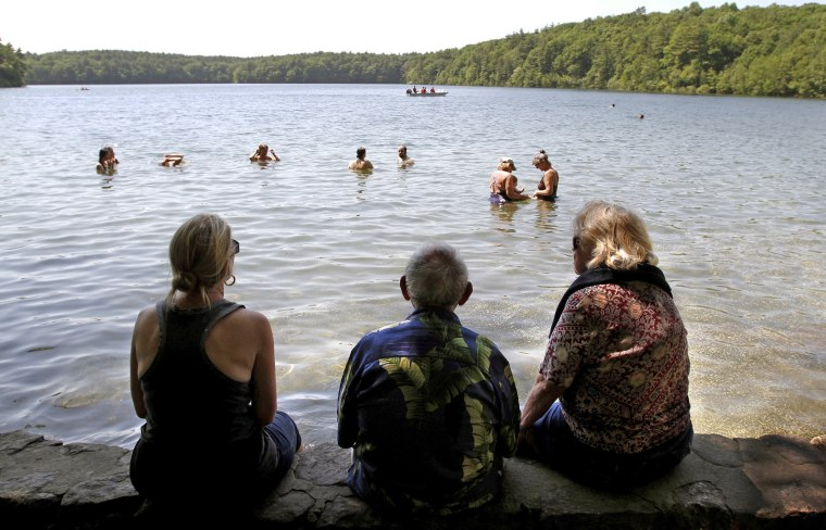 Swimmers enjoy an afternoon at Walden Pond in Concord, Massachusetts.