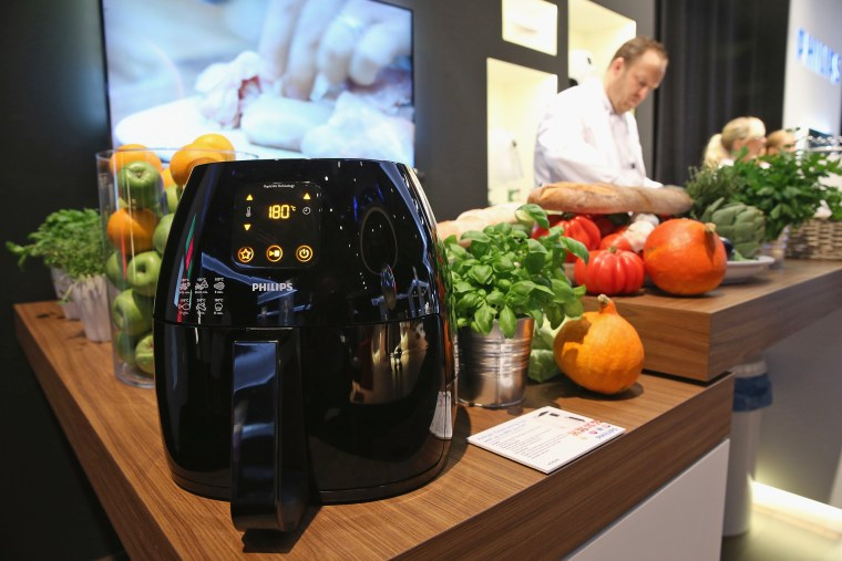 Image: An Airfryer french fries maker stands on display at the Philips stand