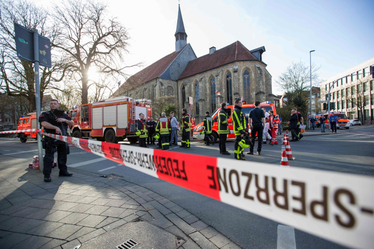 Image: An armed Police officer and first responders are seen at the scene when several people were killed and injured when a car ploughed into pedestrians in Muenster, western Germany on April 7, 2018.