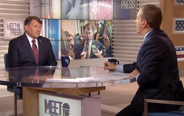 Image: Sen. Mike Rounds (R-S.D.) appears on Meet the Press alongside Chuck Todd, to discuss Syria, the White House's trade threats, and Scott Pruitt's standing with the president, on April 8, 2018.