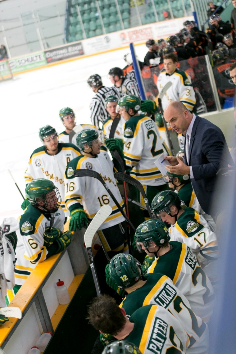 Image: Head coach Darcy Haugan talks to the 2017-2018 Humboldt Broncos Saskatchewan Junior Hockey League team on the bench during a game in this undated handout photo.