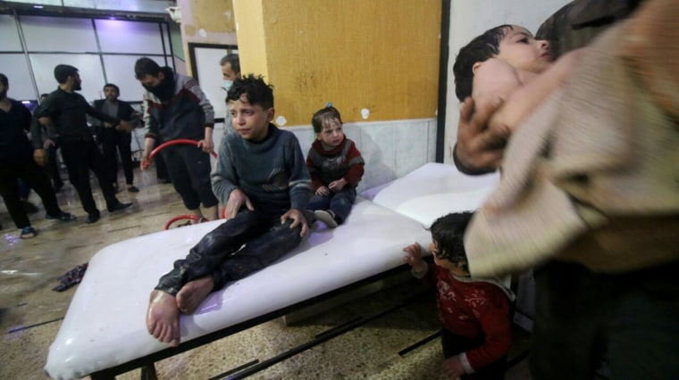 Image: Syrian kids wait to receive medical treatment after Assad regime forces allegedly conducted a poisonous gas attack on Duma, Eastern Ghouta in Damascus, Syria on April 07, 2018.