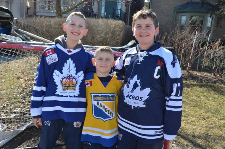 Kristi Ashcroft's 11-year-old son, Jake, pictured on the right next to brothers Connor, 7, in the middle and Charlie, 10 on the left, wanted to their family to participate in the #putyoursticksout movement to support the victims and families of the Humboldt Broncos junior hockey team.
