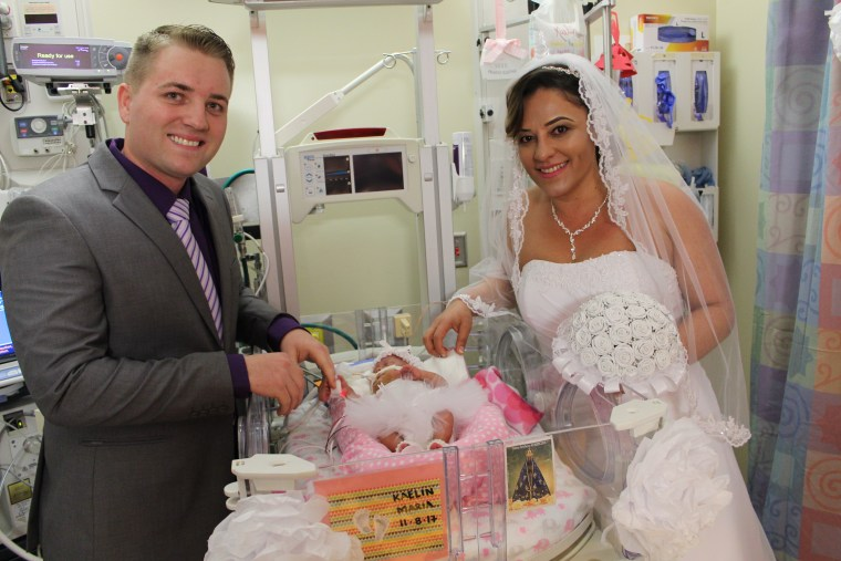 Tyler Campbell and Rubia Ferreira married in the UAB NICU on Valentine's Day beside their daughter, Kaelin's, NICU crib.