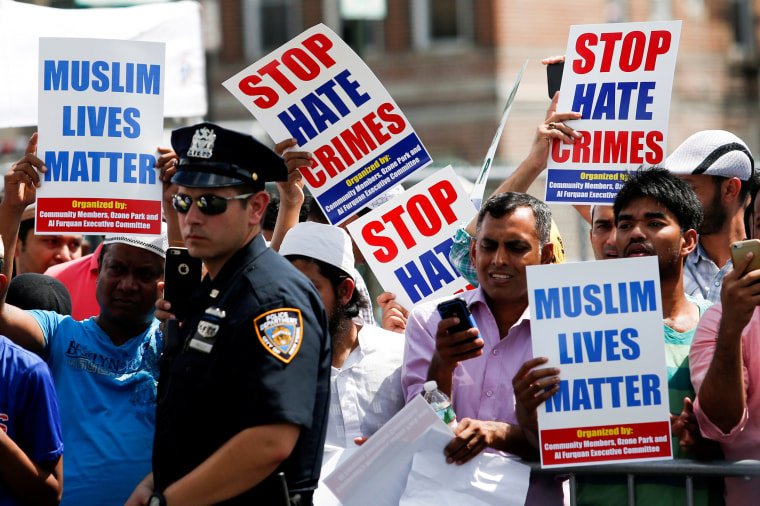 Image: Community members protest during the funeral service of Imam Maulama Akonjee, and Thara Uddin in the Queens borough of New York