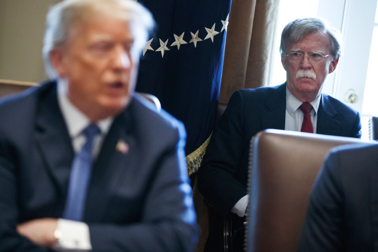 Image: Bolton listens as President Donald Trump speaks