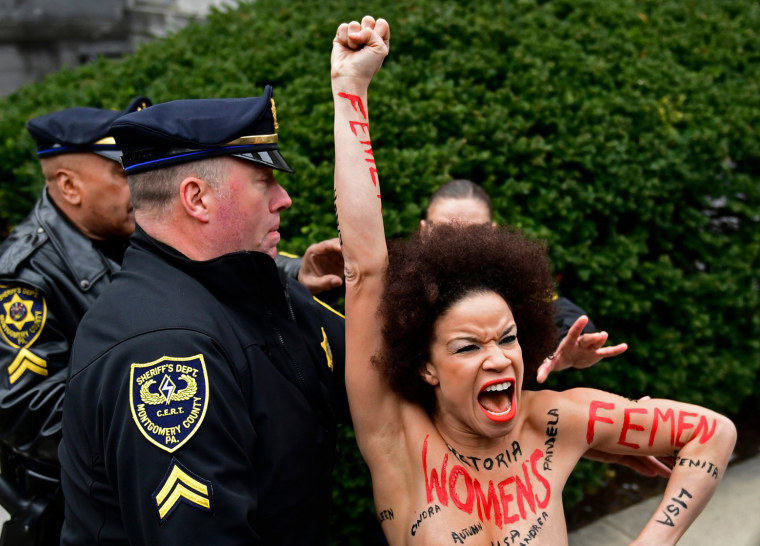 Image: Protester outside Bill Cosby trial