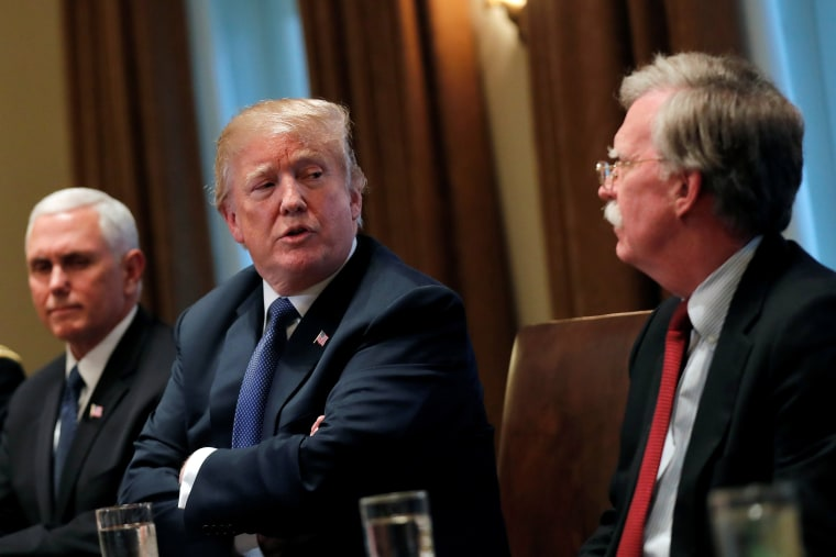 Image: Donald Trump receives a briefing from senior military leadership accompanied by Vice President Mike Pence and new National Security Adviser John Bolton in Washington, DC