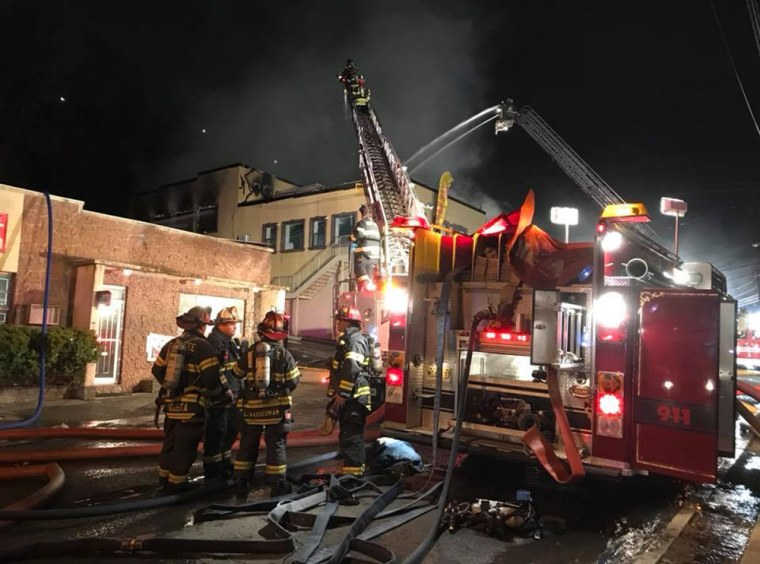 Image: Firefighters work at the scene of a fire in Edgewater