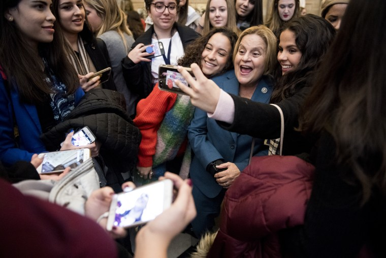 Image: Rep. Ileana Ros-Lehtinen poses for selfies with students